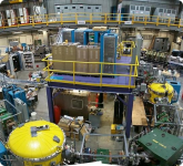 DRAGON's electromagnetic separator consists of two electric dipoles (yellow cylinder to lower left) and two magnetic dipoles (green box to lower right).