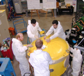 DRAGON members paint the electric dipole a cheerful yellow.